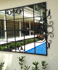 Iron garden mirror designef to be outdoors