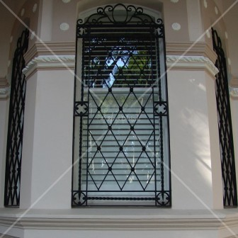 Iron window grill scrolled top