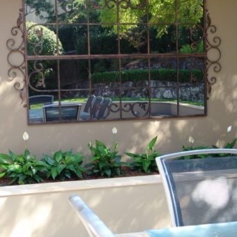 Feature mirror on outdoor wall