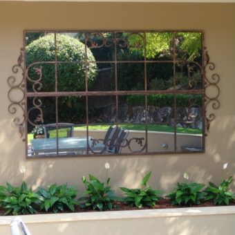 Large scrolled gate mirror
