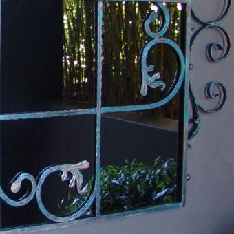 Scrolled gate mirror detail